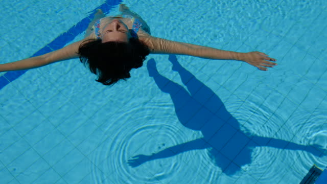 Woman with Shadow Floating on the Water