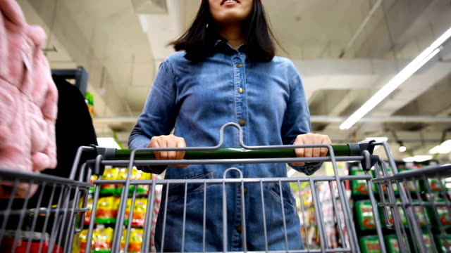 woman with shopping cart in supermarket - handle stock videos & royalty-free footage