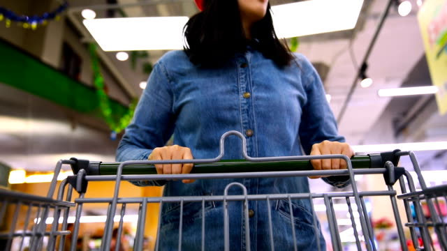 woman with shopping cart in supermarket - pushing stock videos & royalty-free footage