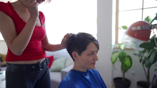 woman with short hair in hairdressing salon - human hair stock videos & royalty-free footage
