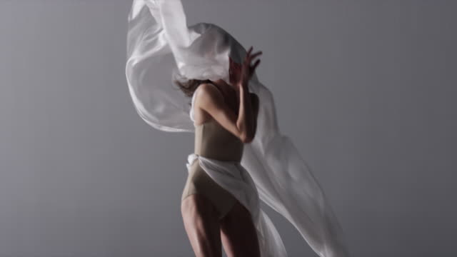 woman with silk draped around her dancing