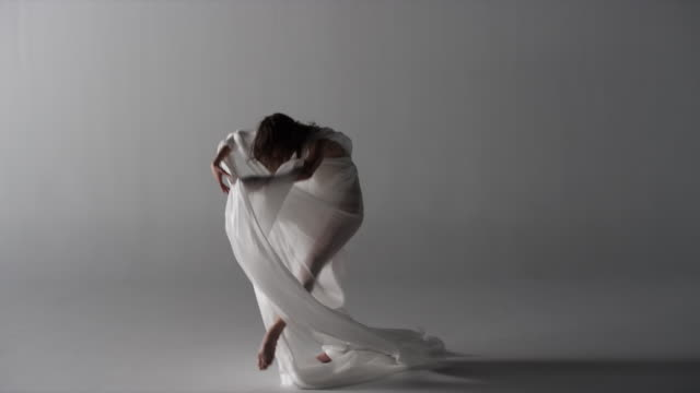 woman with silk draped around her, fabric blows in wind - ballet dancer stock videos & royalty-free footage