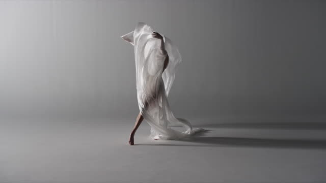 woman with silk draped around her - dance studio video stock e b–roll