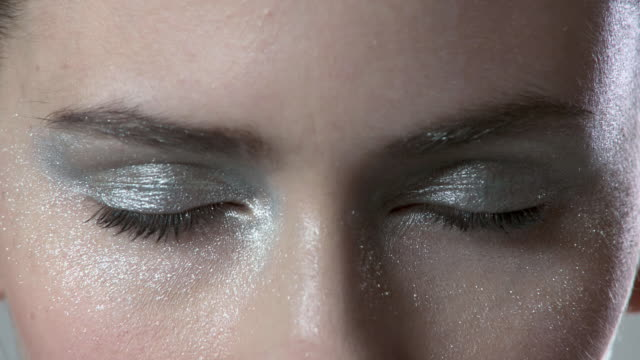 woman with silver make up on her eyes - eyeshadow stock videos & royalty-free footage