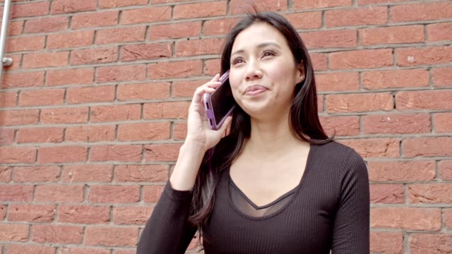 woman with smartphone - brick stock videos & royalty-free footage