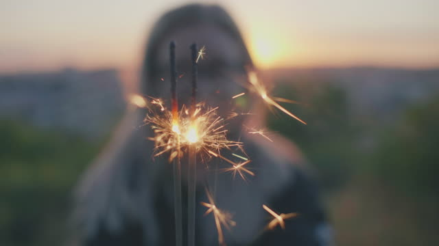 woman with sparkler in sunset - sparkler stock videos & royalty-free footage