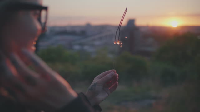 Woman with Sparkler in Sunset