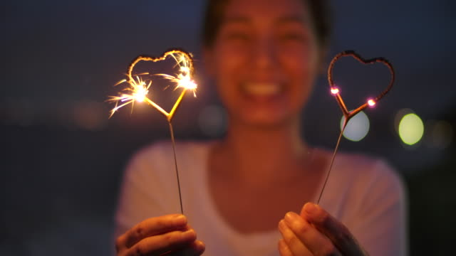 woman with sparklers - explosive material stock videos & royalty-free footage