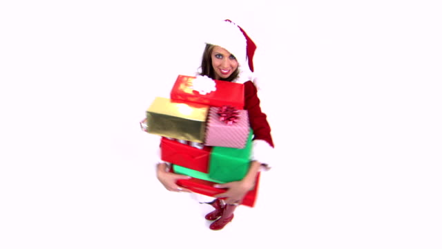 woman with stack of gifts - weihnachtsfrau stock-videos und b-roll-filmmaterial