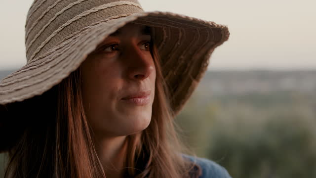 woman with straw hat looking at sunset - daydreaming stock videos & royalty-free footage