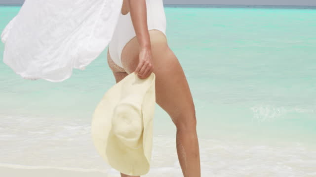ms woman with sun hat on sunny tropical ocean beach,maldives - sun hat stock videos & royalty-free footage
