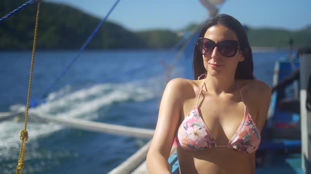 woman with sunglasses sailing on a boat - beautiful people stock videos & royalty-free footage