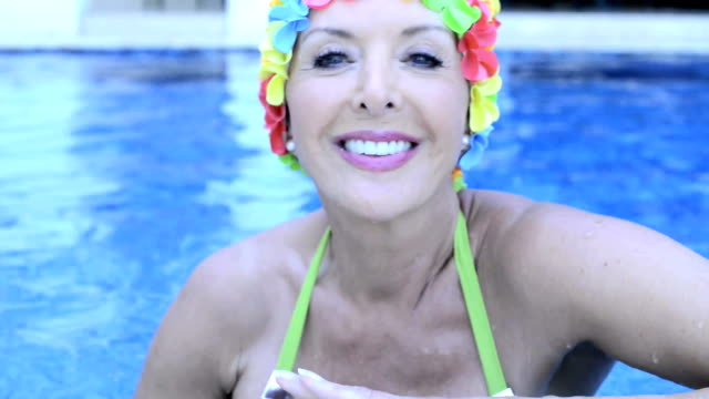 woman with swimming cap smiling - swimming cap stock videos and b-roll footage