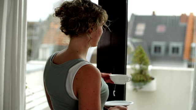 woman with tea cup next to window - staring stock videos & royalty-free footage