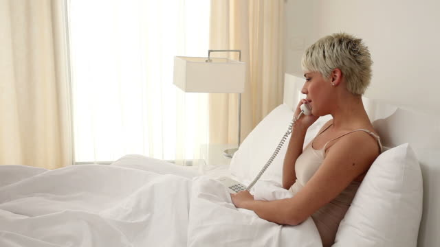 woman with telephone in bedroom - short hair stock videos & royalty-free footage