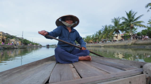 ms woman with traditional vietnamese hat rowing boat - traditionally vietnamese stock videos & royalty-free footage