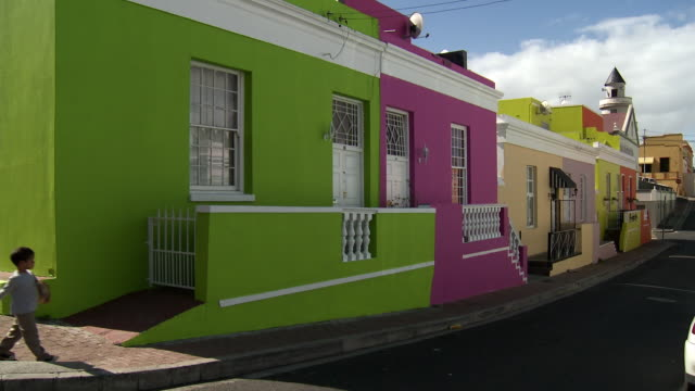 WS Woman with two children passing by brightly colored houses, Bo-Kaap, Cape Town, Western Cape Province, South Africa