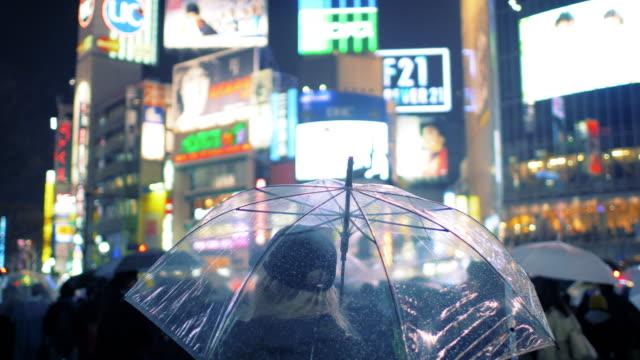 woman with umbrella at shibuya crossing - shibuya crossing stock videos & royalty-free footage