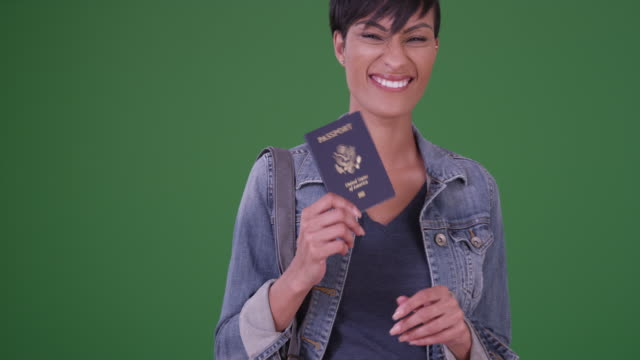woman with us passport on green screen - verification stock videos & royalty-free footage