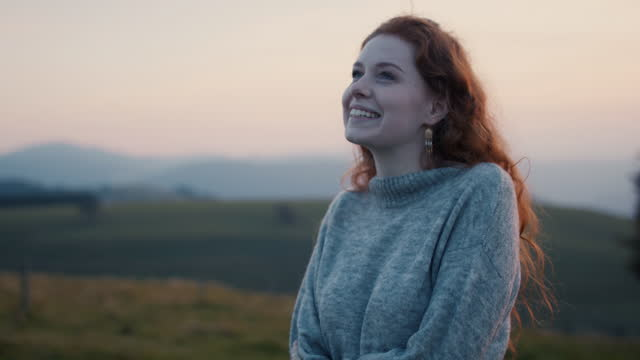 woman with warm sweater against evening sky - eyes closed stock videos & royalty-free footage