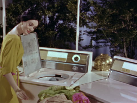 1964 woman with washing machine / laundry appears suddenly she starts loading washer / industrial - prelinger stock videos & royalty-free footage