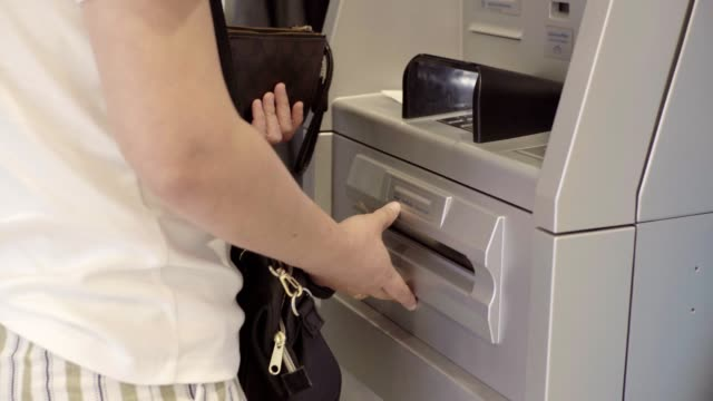 woman withdraws cash from atm. - banknote stock videos & royalty-free footage