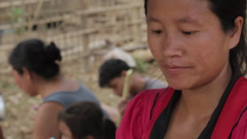 cu tu woman work on sugarcane pressing machine / vang vieng, vientiane, laos  - one mid adult woman only stock videos & royalty-free footage