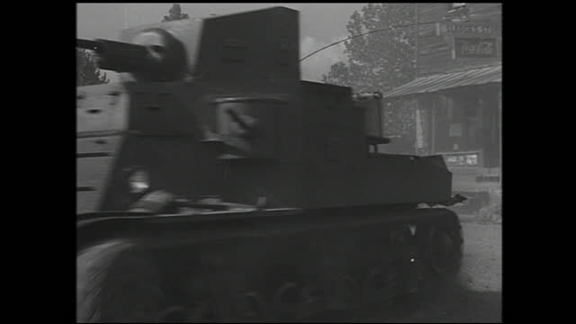 woman worker assembling small components inside factory; tank driving on the street and soldiers retreating - 1940 1949 video stock e b–roll