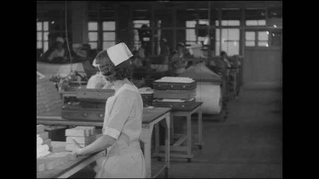 hd woman worker dressed in cap amp knee length uniform carrying supplies to table two women sorting blocks td ms female workers standing at table... - length stock videos & royalty-free footage