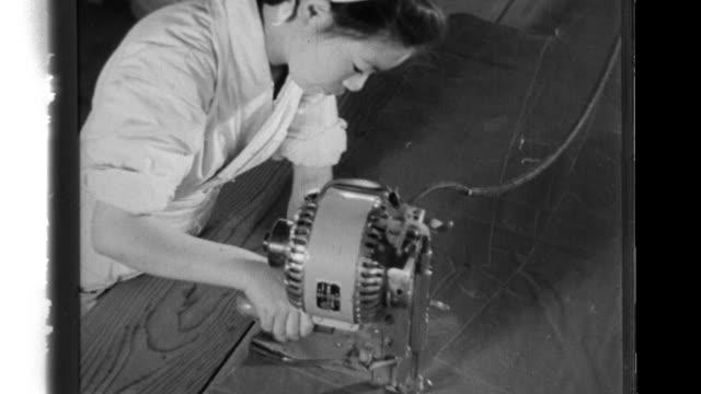 vídeos y material grabado en eventos de stock de woman workers and student volunteers work industriously in a textile plant that produces military clothing. - cinta de cabeza