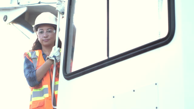 woman working as a crane operator - crane stock videos & royalty-free footage
