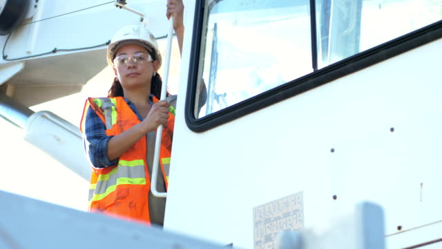 woman working as a crane operator - construction worker stock videos & royalty-free footage