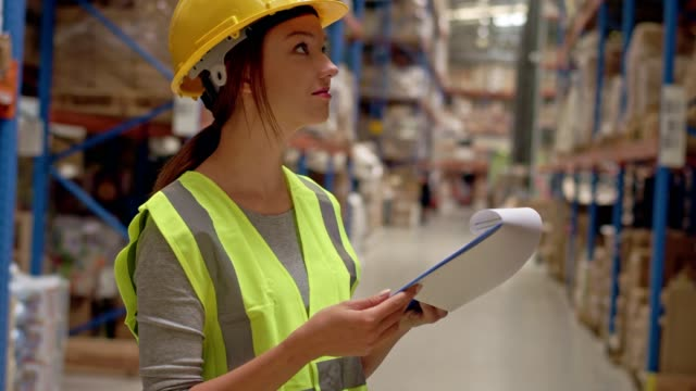 woman working at a warehouse. counting stocks - satisfaction stock videos & royalty-free footage
