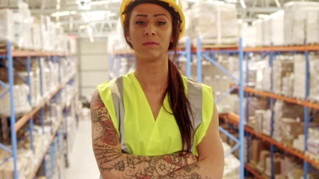 woman working at a warehouse - satisfaction stock videos & royalty-free footage