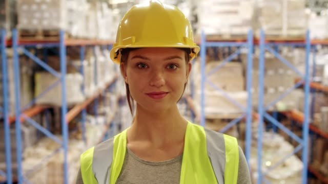 woman working at a warehouse - group of objects stock videos & royalty-free footage