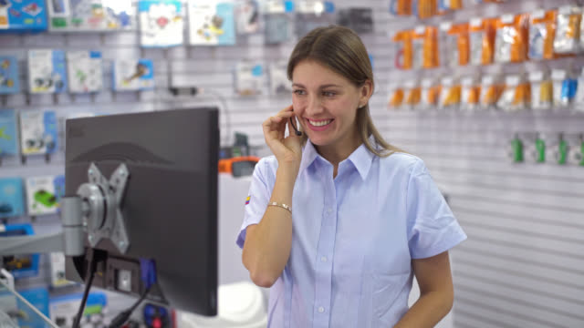 woman working at an electronics store - electrical equipment stock videos & royalty-free footage