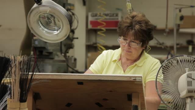 ms woman working at drafting table / nazareth, pennsylvania, usa - 製図板点の映像素材/bロール