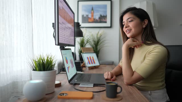 woman working at home talks to virtual assistant - voice stock videos & royalty-free footage