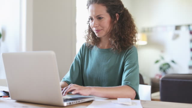 woman working at home with laptop. - only women stock videos & royalty-free footage