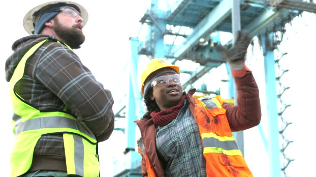 woman working at seaport, talking with co-worker - docks stock videos & royalty-free footage