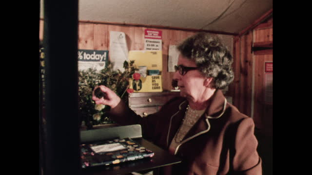 woman working at small post office, 1970s - poster stock videos & royalty-free footage