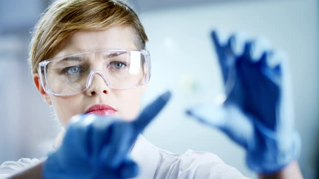 Woman working at the laboratory - clean version