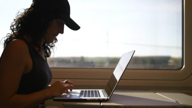 woman working at the train - interno di treno video stock e b–roll