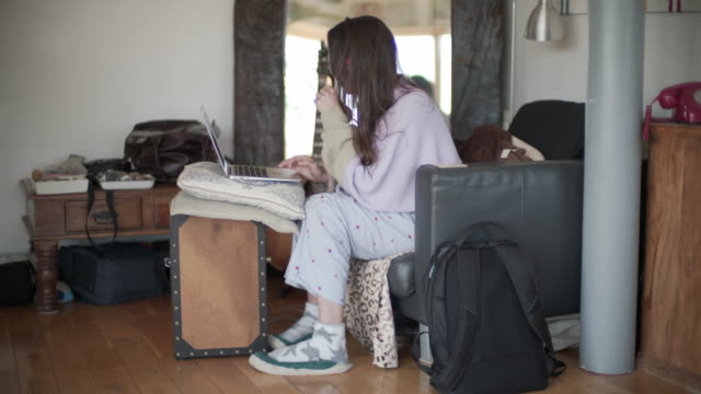a woman working from home in her pj's - part of a series stock videos & royalty-free footage