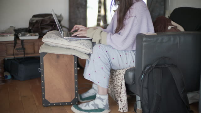 a woman working from home in her pj's - pyjamas stock videos & royalty-free footage