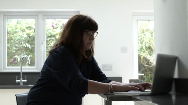 woman working from home using laptop. - candid stock videos & royalty-free footage