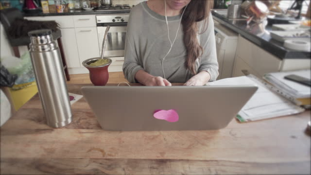 a woman working from home - messy stock videos & royalty-free footage