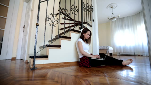 woman working from home - sitting on floor stock videos & royalty-free footage