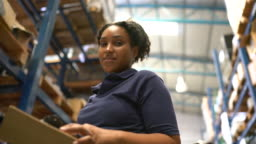 Woman working in a factory warehouse