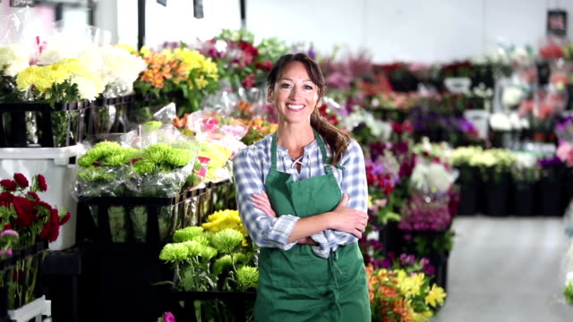 woman working in a flower shop - hand on hip stock videos & royalty-free footage